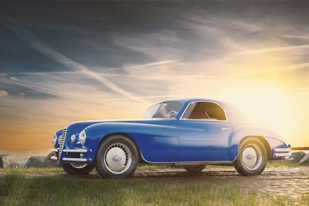 Classic blue car at sunset - Auto Insurance