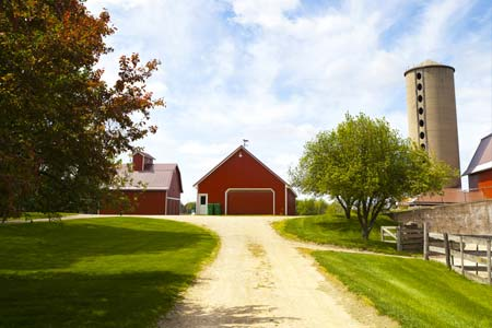 Rural farm with red barns and a silo - Farm Insurance